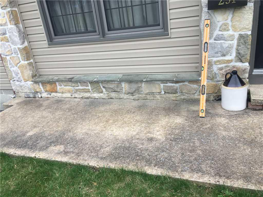 Sinking Concrete Front Patio in Marietta, PA - Before Photo