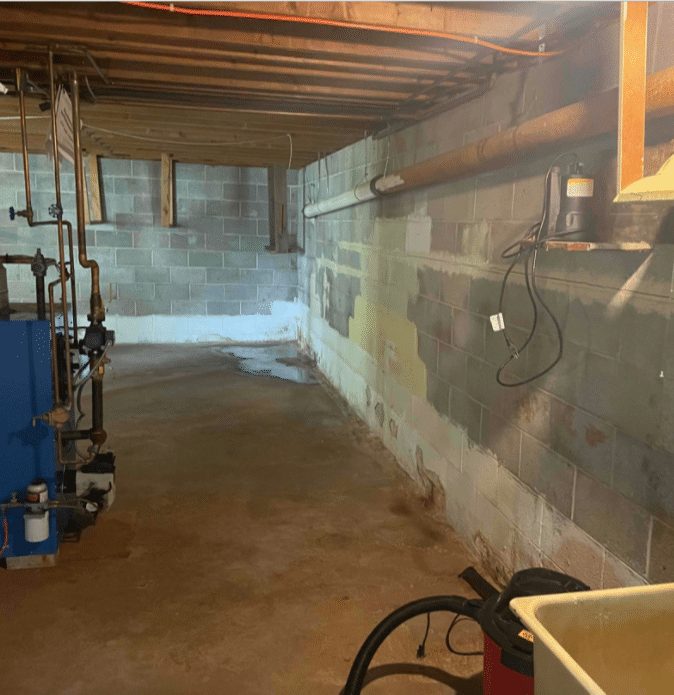 Spring City, PA in Basement Puddle - Before Photo