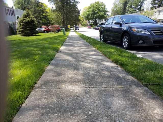 Sinking Sidewalk by Lafayette Hill, PA Home