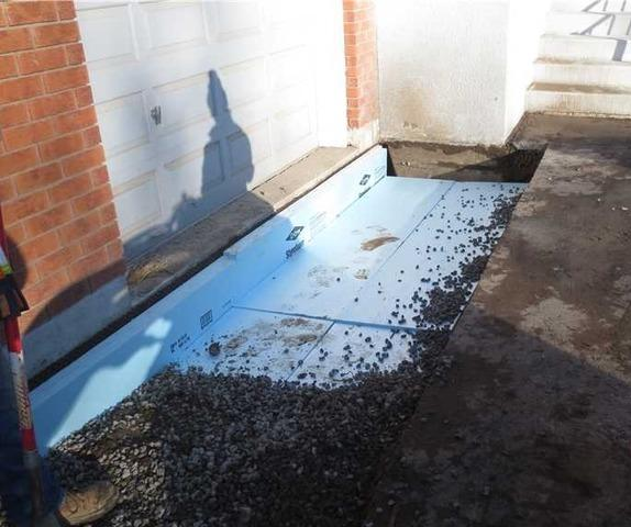 Frozen Fill Soils Below Garage Lead to Step Cracking in Foundation in Janetville, Ontario