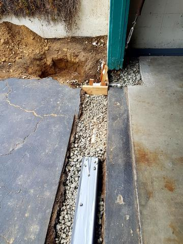 Interior Drainage System Between Santa Barbara, CA Garage & Driveway - Before Photo