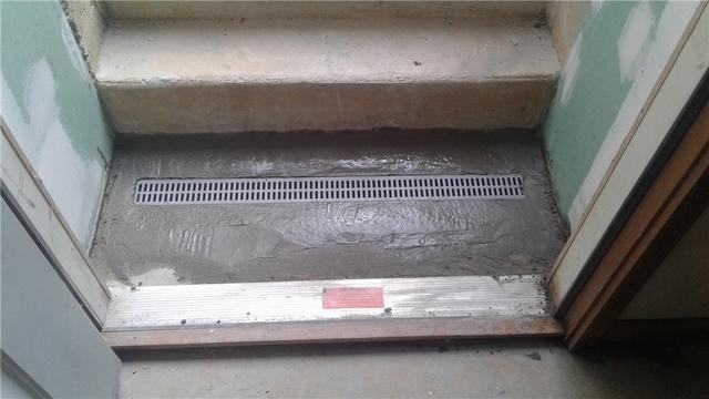 TrenchDrain Stops Water at Basement Doorway in Blandon