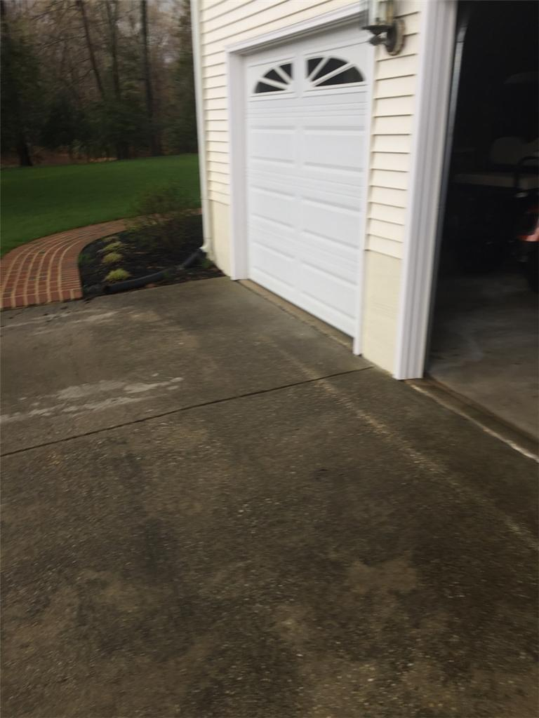 A Sinking Driveway is Lifted and Made Safe Again by DryZone in Waldorf, MD - Before Photo