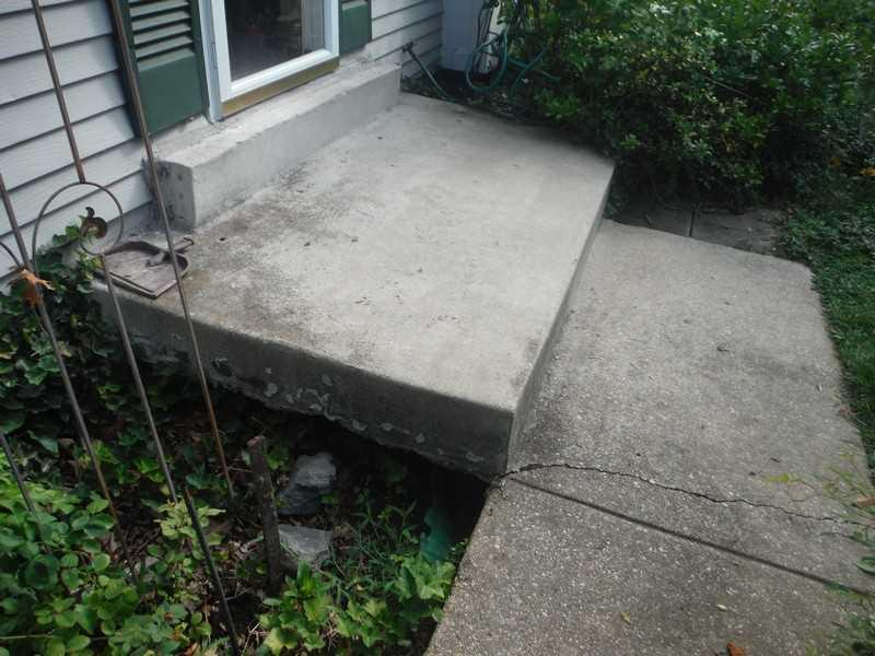 Void Fill Under Front Steps in Laurel, MD - Before Photo