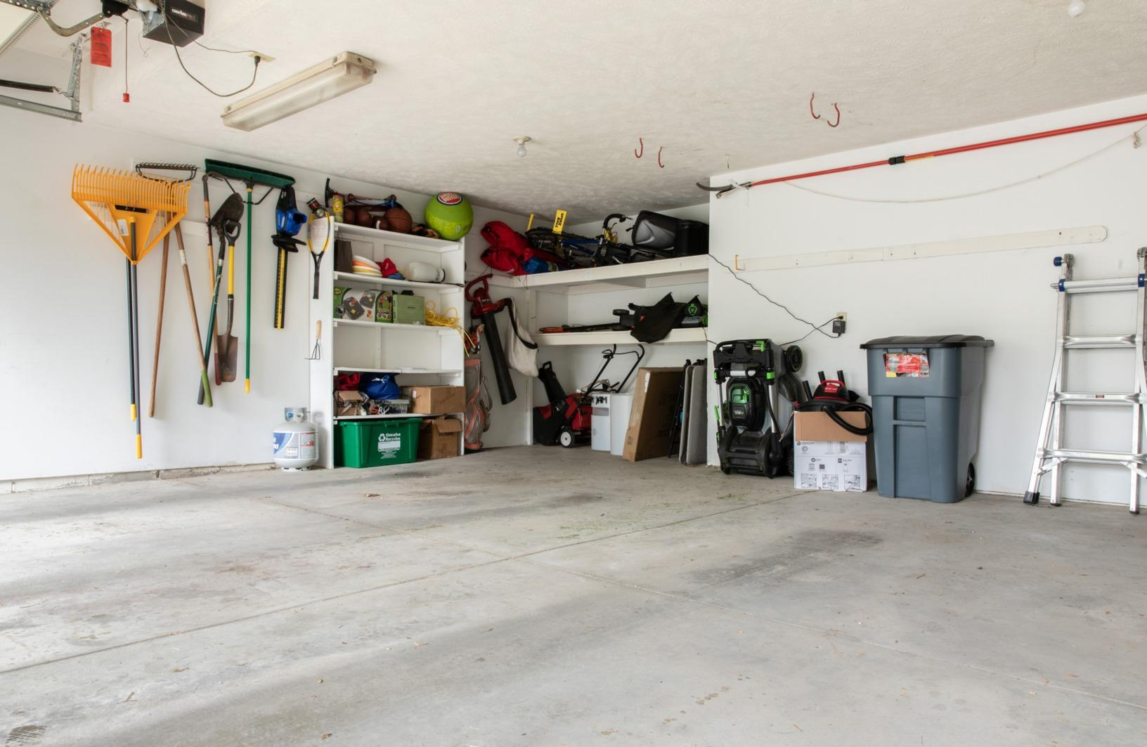 Gear Filled Garage Gets Lifetime Transformation in Lewes, DE - Before Photo