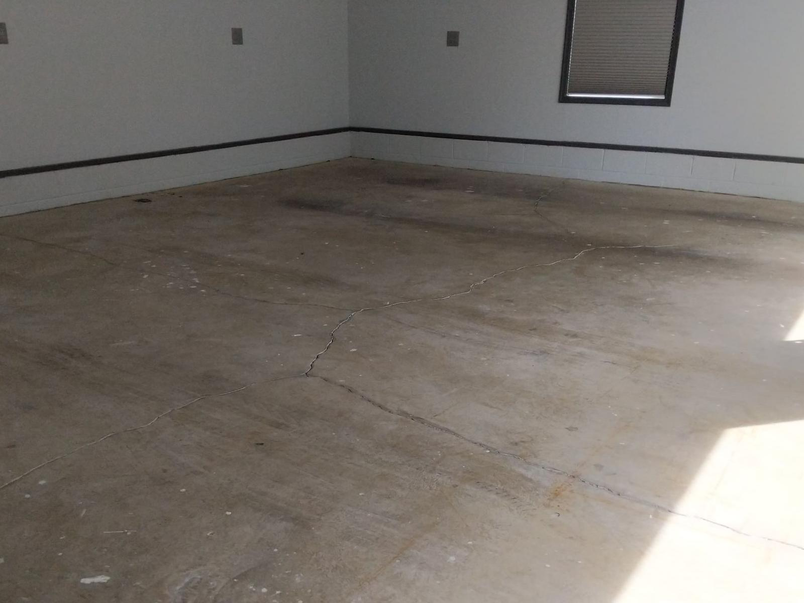 PolyLevel and Garage Floor Coating in Middle River, MD - Before Photo