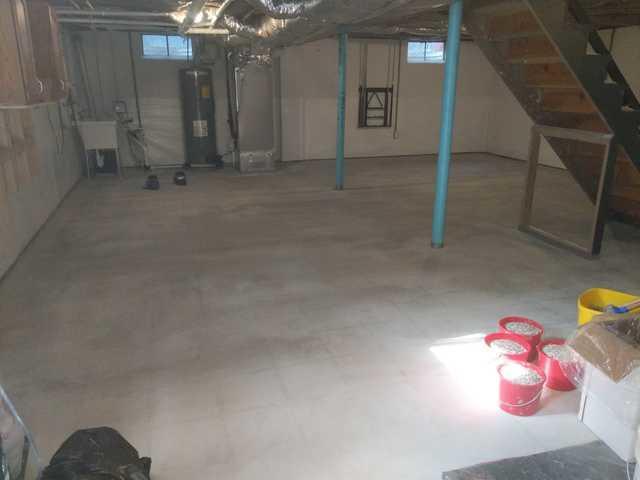 Basement Floor Transformed with SparTek Concrete Floor Coating in Rehoboth Beach, DE - Before Photo