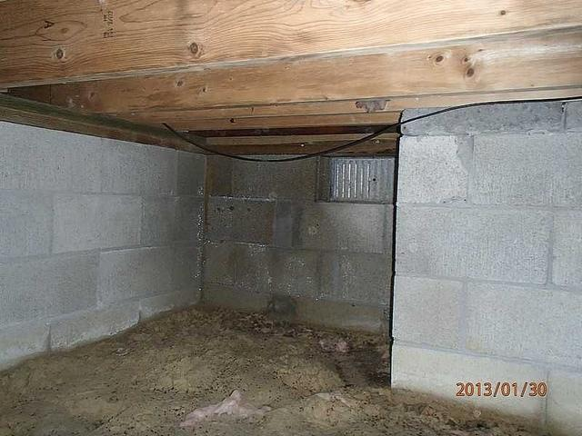 Ocean City, MD - Dirt and sand floor on a crawlspace gets sealed up from the elements