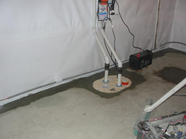 Open, dirty sump pump to a new TripleSafe system!