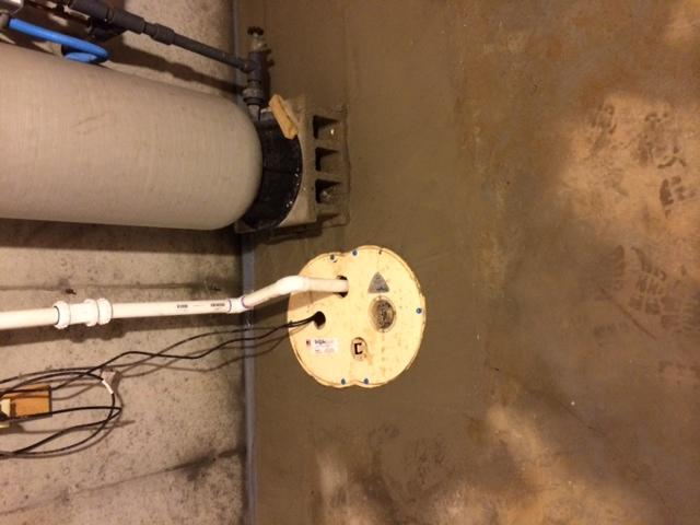 Dry Zone installs Sump Pump in Eastham Basement