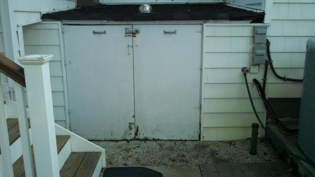 Rotted crawl space access doors allow in feral cats and fleas - Crawl space encapsulation in Lanoka Harbor, NJ