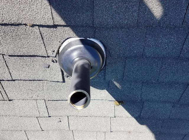 Old vent boots gets replaced from this Atlantic Highlands home