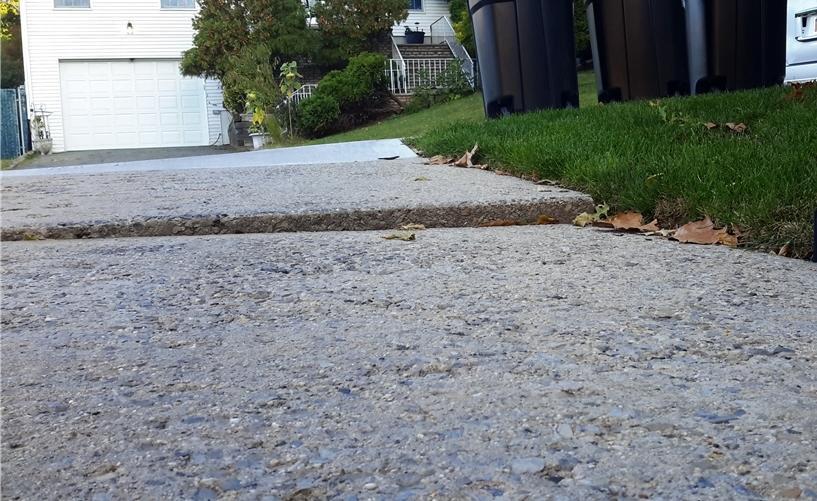 Sidewalk Leveled in Staten Island, NY - Before Photo