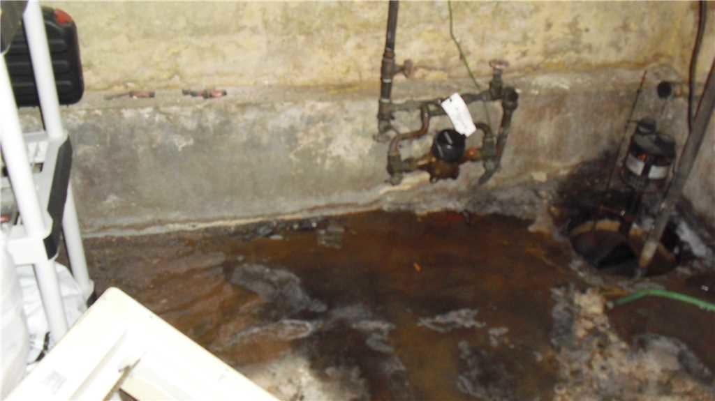 Basement Waterproofing Systems installed in Staten Island, NY - Before Photo