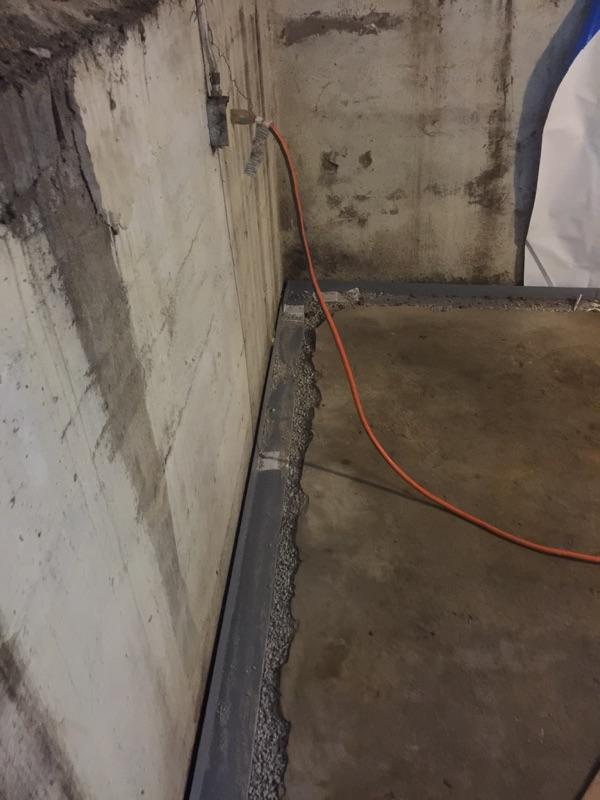 Leaky basement in need of a permanent drainage solution - After Photo