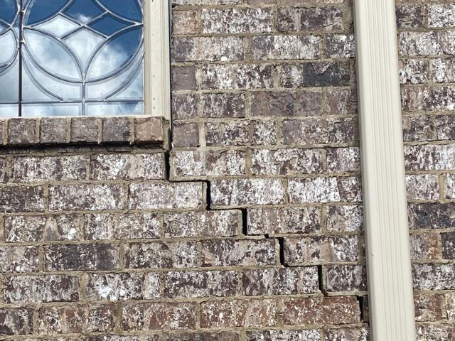 Piering Project in Corinth Mississippi Cures Cracks in Brick Wall - Before Photo