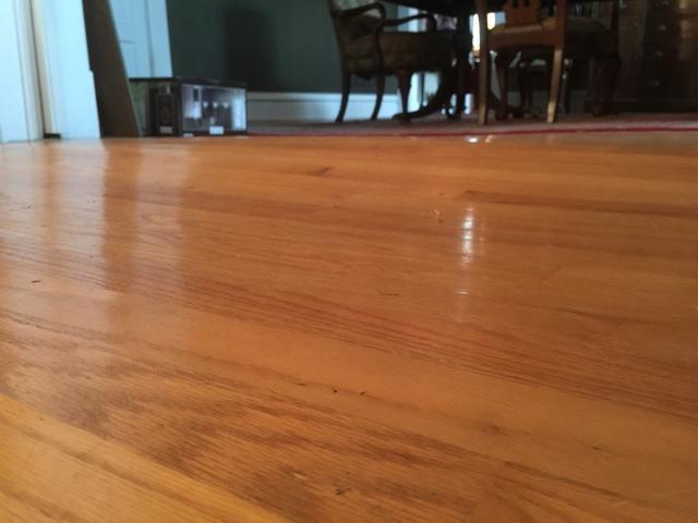 Wave in wood flooring as a result of broken floor joists
