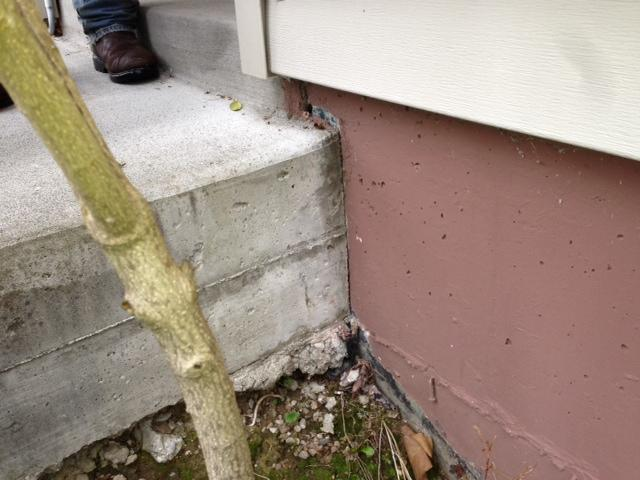 Concrete Lifting & Leveling on Front Stoop in Seattle, WA - Before Photo