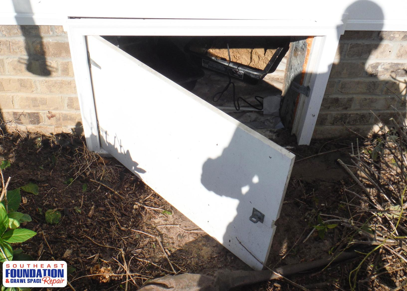 Crawl Space Door to a Turtl in Pikeville, NC - Before Photo