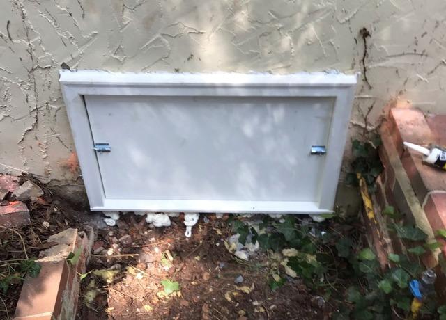 Replacing an Old Crawl Space Door with a New Door After Encapsulation in Southern Pines, NC