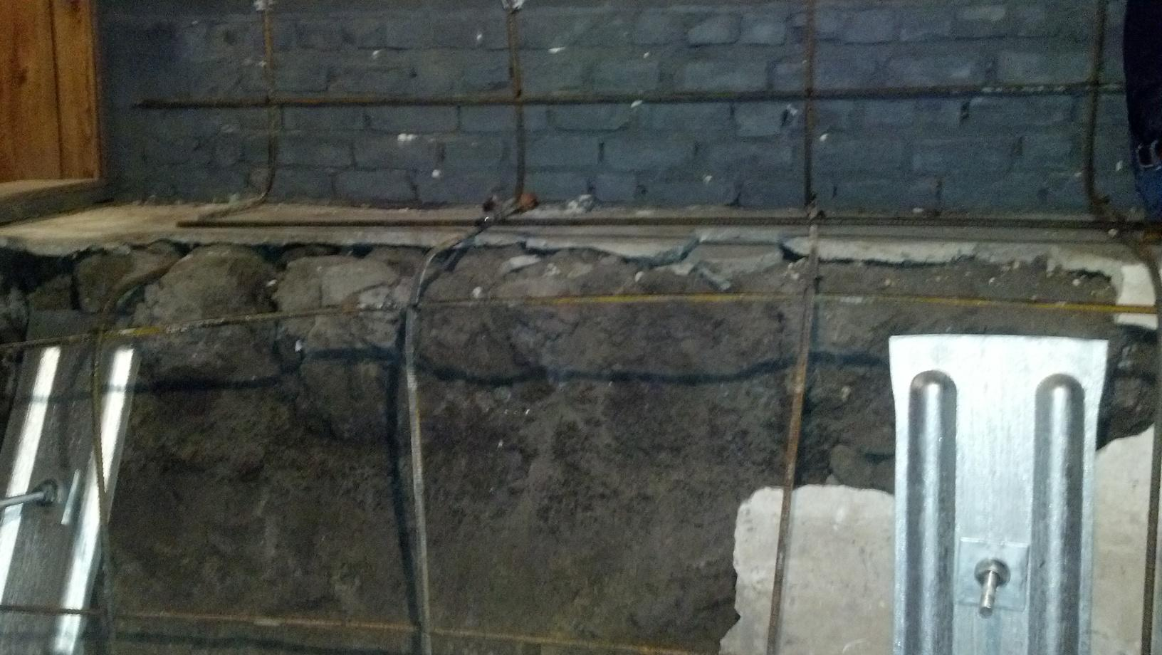Shotcrete and Wall Anchors to stabilize a bowing wall - Before Photo