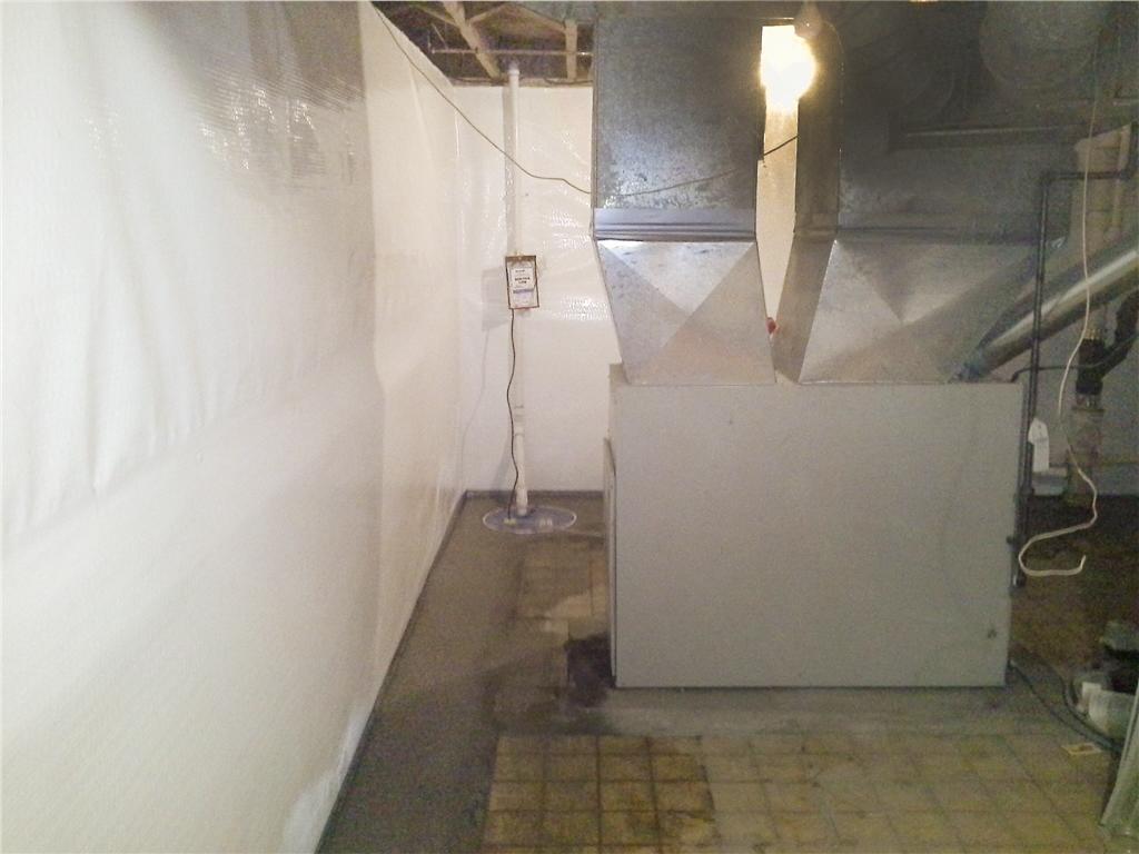 Basement Wall Insulation in Burlington, Vermont - Before Photo