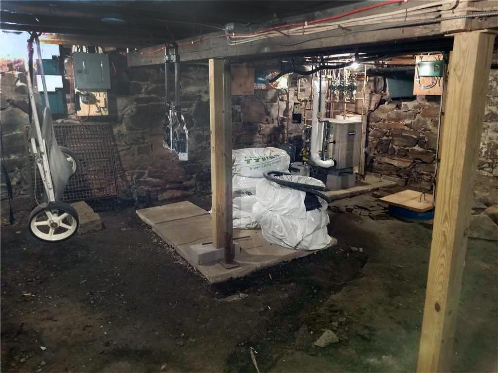 Matt Clark's Northern Basement Systems installs a New Slab and Smart Jacks in Burlington, Vermont - Before Photo