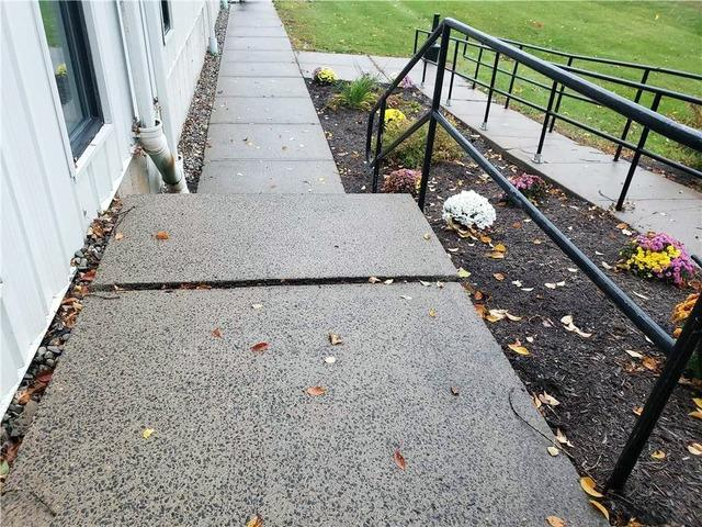 Matt Clark's Northern Basement Systems fixes a side walk with Polylevel injection in Plattsburgh, New York - Before Photo