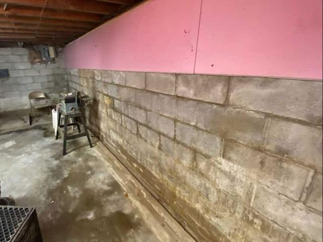 Fixing a bowing wall in St. Albans, Vermont.