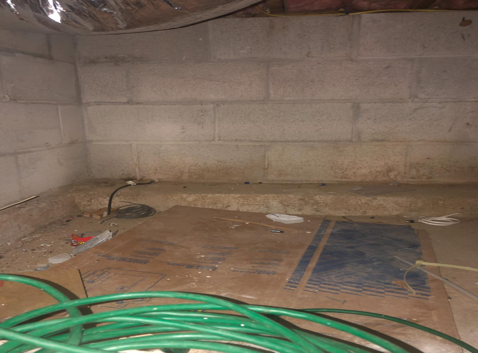 Old, ugly crawl space turns into clean usable crawl space - Before Photo