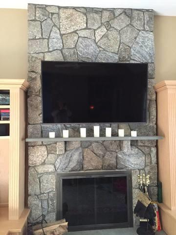 TV Mount Over Stone Fireplace in New Canaan, CT