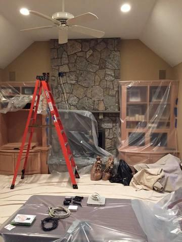TV Mount Over Stone Fireplace in New Canaan, CT - Before Photo