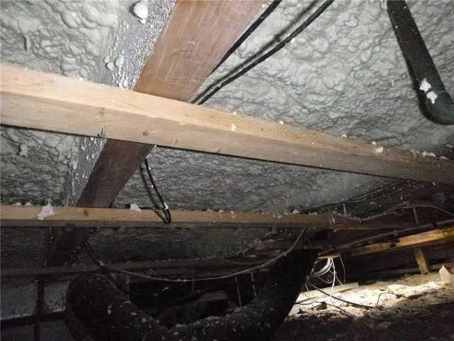 Insulating under a open floor in Dewey Beach, Delaware