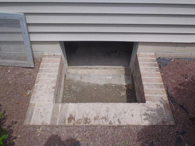 Crawl Space Entry Repair in Seaford, DE - Before Photo