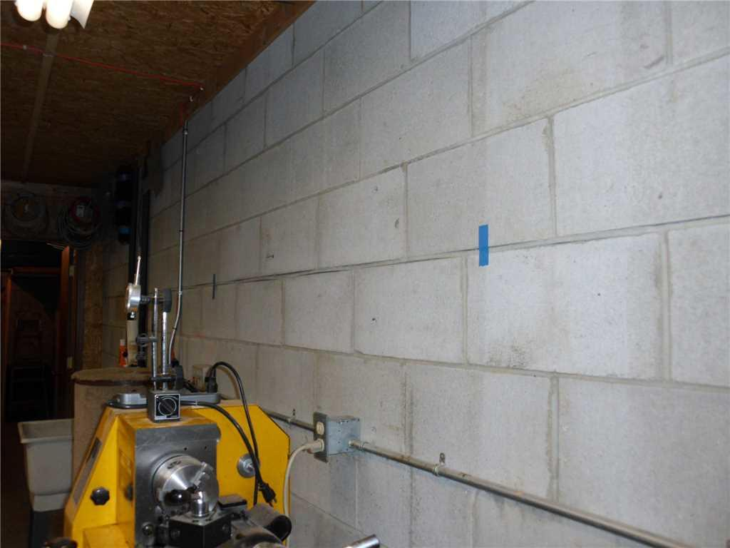 Bowing Foundation Wall Stabilized in Chanhassen, MN - Before Photo