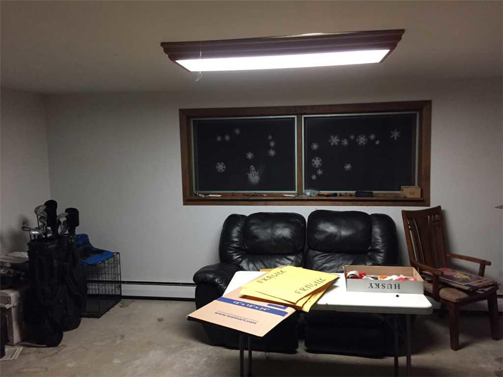 French Doors installed in an Eau Claire, WI  basement - Before Photo