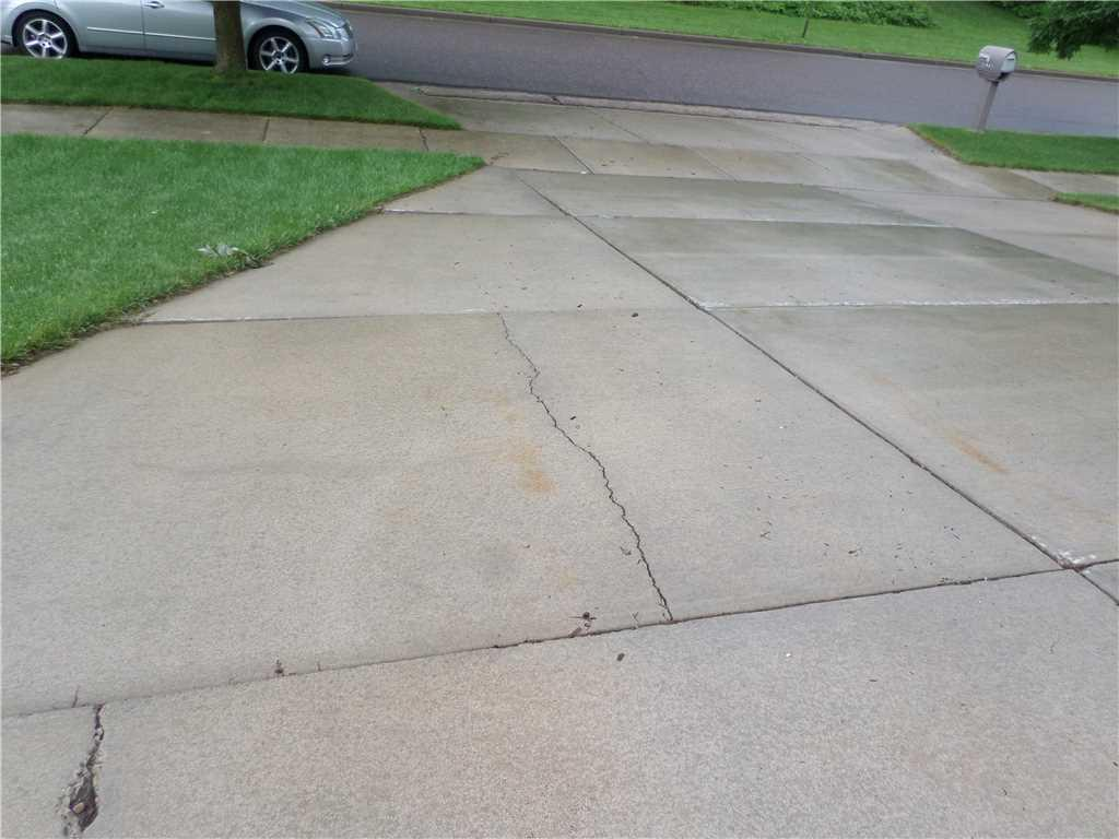 Altoona, WI driveway cracks sealed - Before Photo