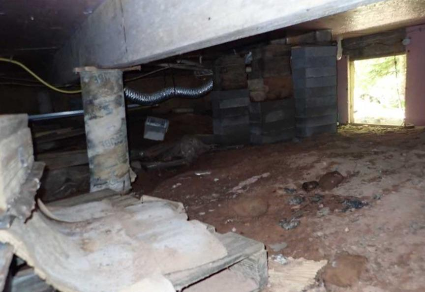 Crawl Space Encapsulation and Waterproofing to Address Moisture and Sinking in Bayfield, WI - Before Photo