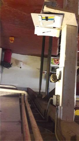 Basement support beam secured with SmartJack® system