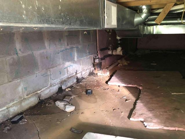 Cracked Crawlspace Cinderblock Foundation Repaired With Supportworks® PowerBrace™ Wall Support System In Isanti, MN