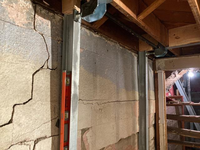 Sinking Minneapolis, MN Home Lifted with DBS Push Piers