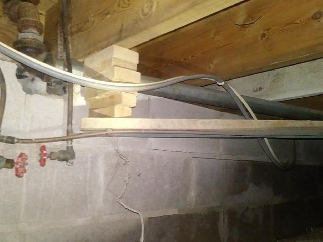 Cracked Crawl Space Foundation Repaired Using Supportworks® PowerBrace® System In Winter, Wisconsin
