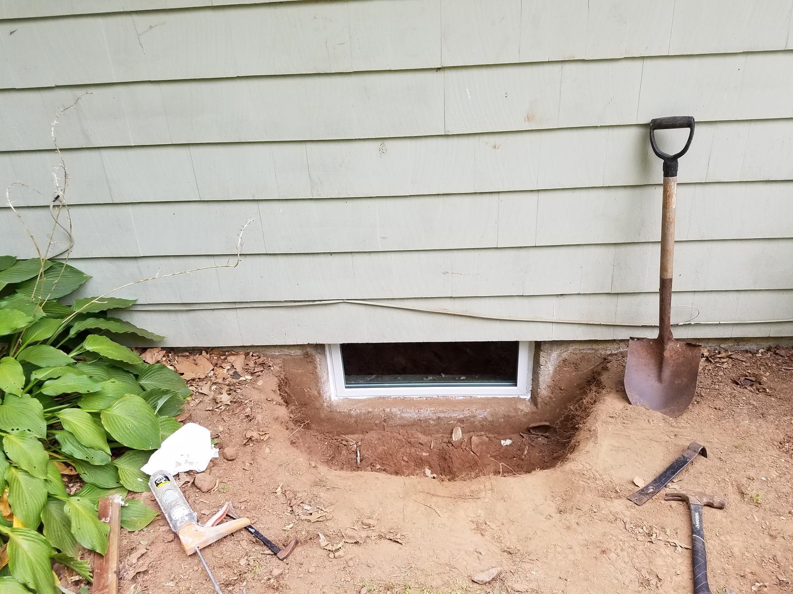 Installing Basement Window Wells in Bloomfield, CT - Before Photo