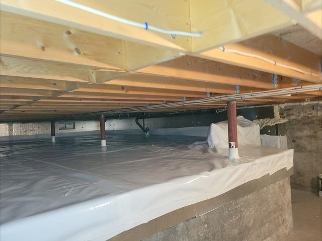Replacing Old Insulation Under Home in Belchertown, MA