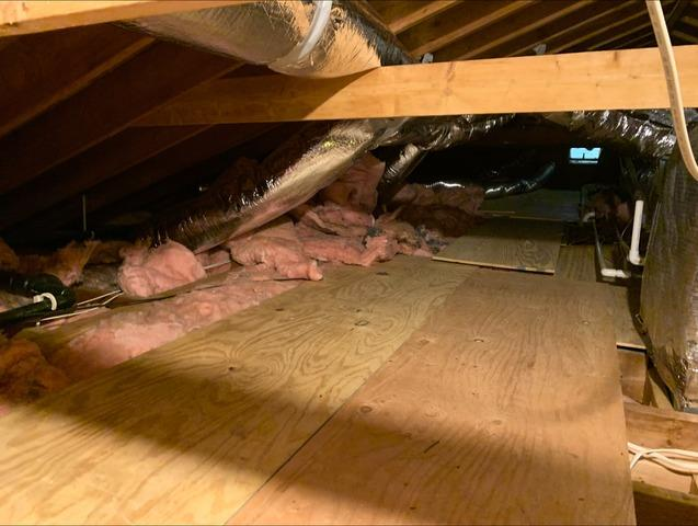 Removal Of Old Inefficient Insulation in an attic in Coventry, CT - Before Photo
