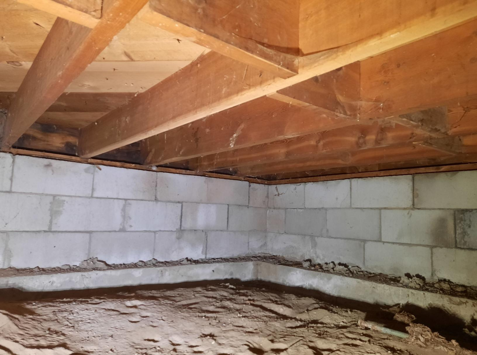 Permanently Stabilizing Sloping Floors in a Laurel Home - Before Photo