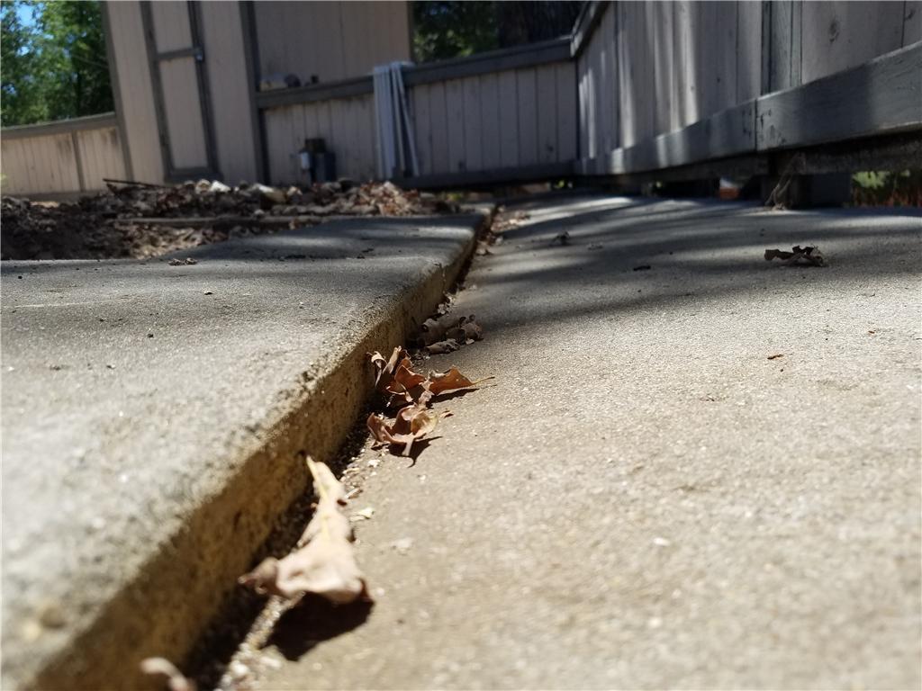Uneven Backyard Patio - Before Photo