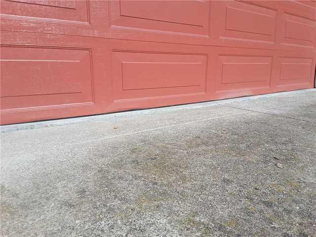 Remove tripping hazard between driveway and garage - Lafayette, CA