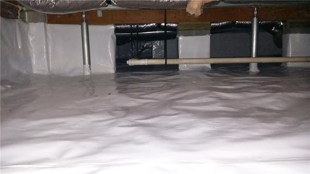 High Humidity Levels in Crawl Space Warps Floorboards throughout Mt. Pleasant Home