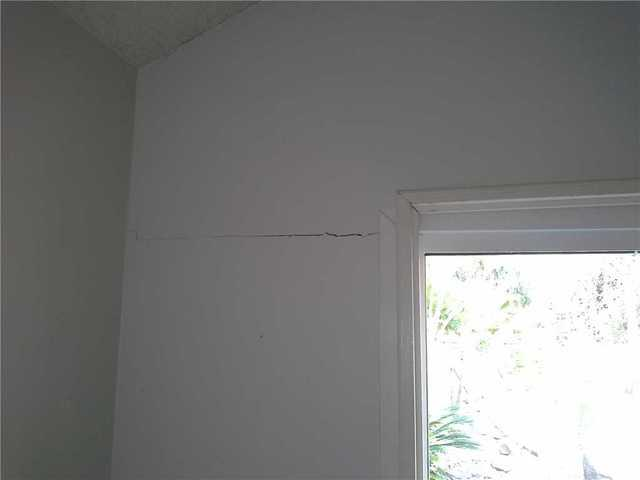 Interior crack before and after push pier lift and stabilization.